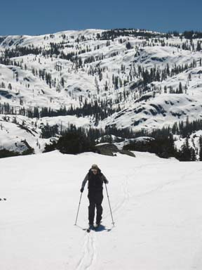 Image of skier skiing back to Peak 6893 after exploring the ridge beyond the peak