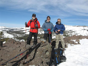 Image of skiers on top of Andesite Peak.