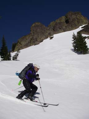 Image of skier descending from saddle near Benson Hut