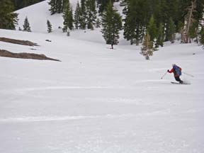 Image of skier descend from final saddle