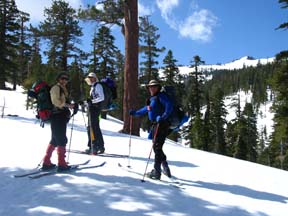 Image of skiers on ridge leading to Deep Creek