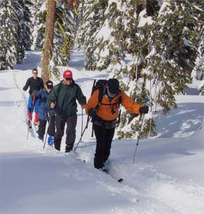 Image of skiers on ridge to Trail Junction