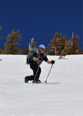 Image of skier at top of Ten Turn Hill
