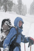 Image of skier in storm on route to Ostrander Hut
