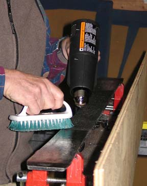 Image of removing wax using heat gun